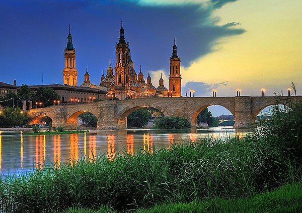 Basilica of Our Lady of the Pillar and the Puente de Piedra bridge on the Ebro River Saragossa Spain