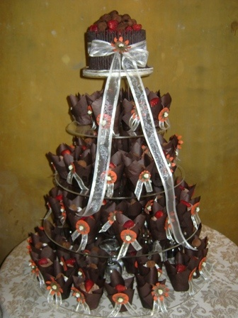 Chocolate Cigarello Wedding Cutting Cake with Truffles and Strawberries and Cupcake Stack