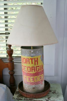 old chicken feeder and made it into a  crude lamp-LOVE! Need to do this!!