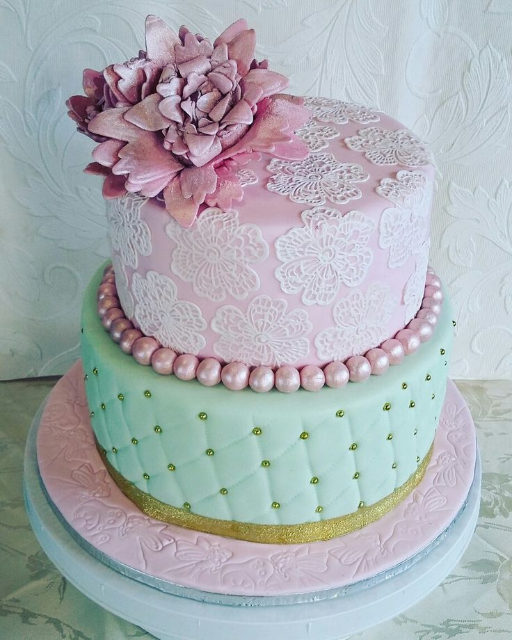 Pastel cake with edible lace and gumpaste flower