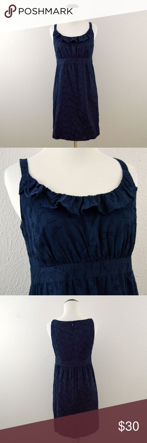 LOFT Navy Blue Dress Navy blue sleeveless dress by Ann Taylor LOFT. Has a floral embroidered detail throughout the dress. In great condition!  | Measurements | Size: 4 Petite All flat lay measurements are provided in image above and are approximate.  | Materials | 100% cotton. Machine washable! LOFT Dresses Mini