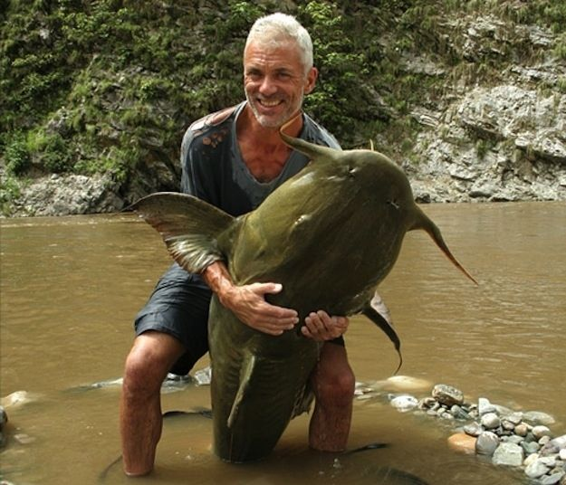"""A 161-pound goonch catfish, caught in a river in northern India. This catch measured 5 feet, 7 inches from head to tail with a 41-inch girth and 44-inch """"wingspan."""""""
