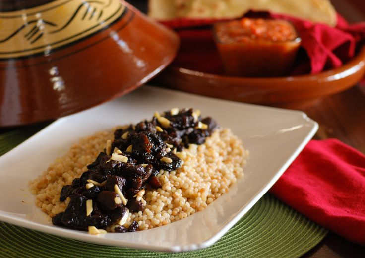 Lahm Lhalou (Lamb Stewed with prunes) Served over Couscous