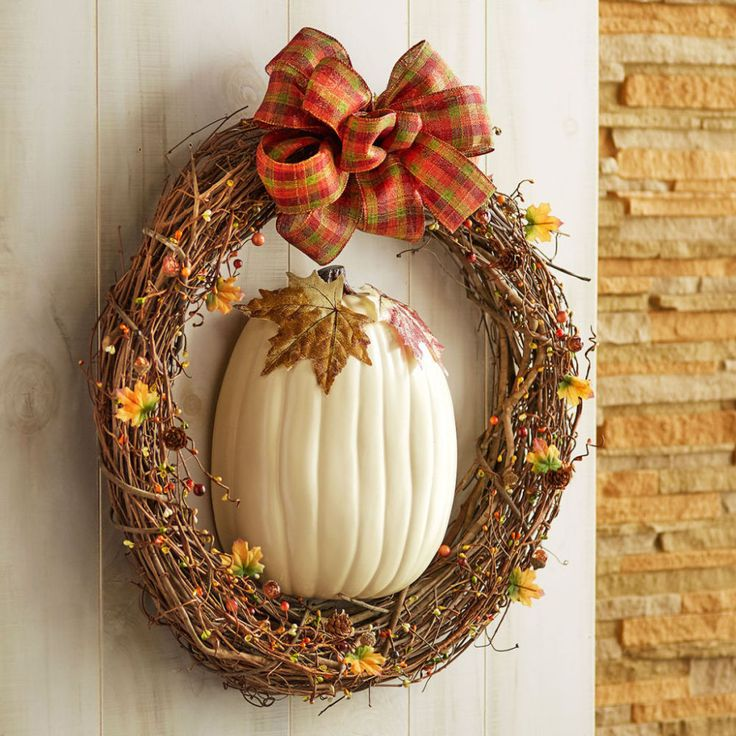 Greet your guests with this simple DIY fall pumpkin wreath. Our craft pumpkins now come pre-cut in half, which makes this project one step simpler!