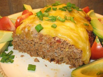 TACO MEATLOAF (ground beef with taco seasonings, salsa and cheese mixed in with meat) topped with refried beans and cheese...original recipe by Coleen's Recipes.