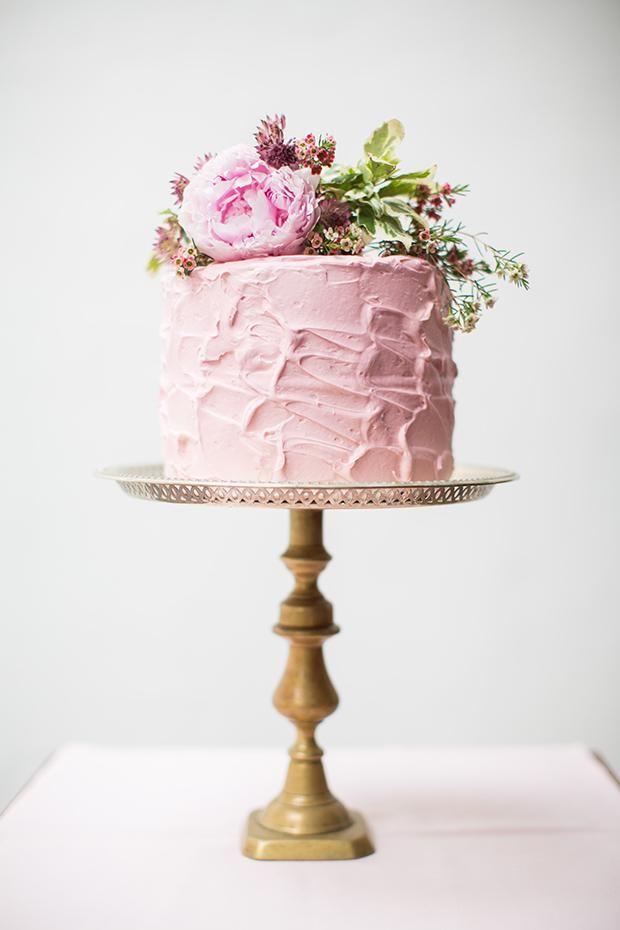 pink mini cake on a vintage brass pedestal