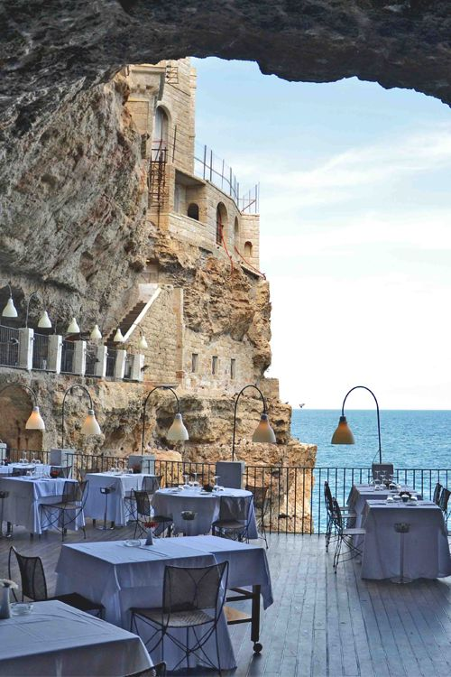 Grotta Pallazzese. This restaurant is part of a cave in a cliff in southern Italy. The Restaurant is located in Polignano a Mare, Bari.