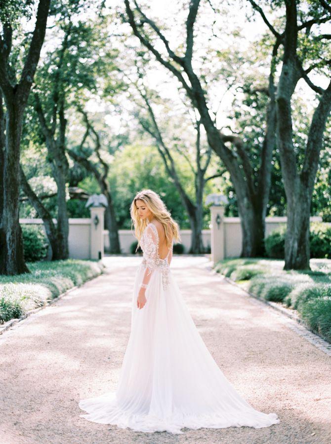 Gorgeous elegant soft beaded Zanzis Couture wedding dress: http://www.stylemepretty.com/louisiana-weddings/new-orleans/2016/09/22/meet-mysterieuse-dame/ Photography: Katie Grant - http://www.katiegrantphoto.com/