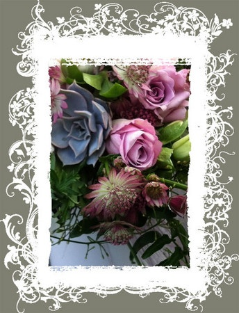 Succulents, Memory Lane Roses and spring hellebores with spanish moss