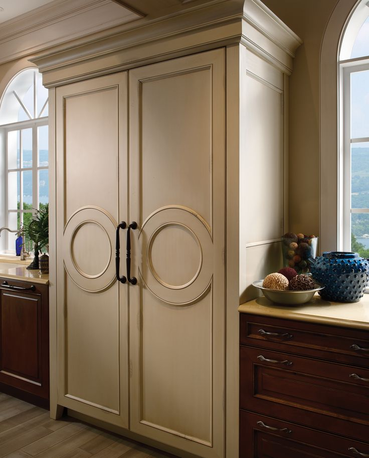 Custom Kitchen Cabinets Houston: Traditional Refrigerator Panel With Medallion Inserts