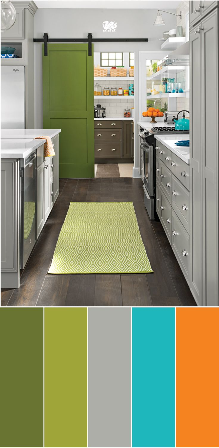 The best way to introduce bright colors in a space? Create a singular focal point of a shade you love and build the rest of the scheme around it, like this bold green pantry door highlighted with warm grays, White Cliff™ quartz, and complementary citrus accents.