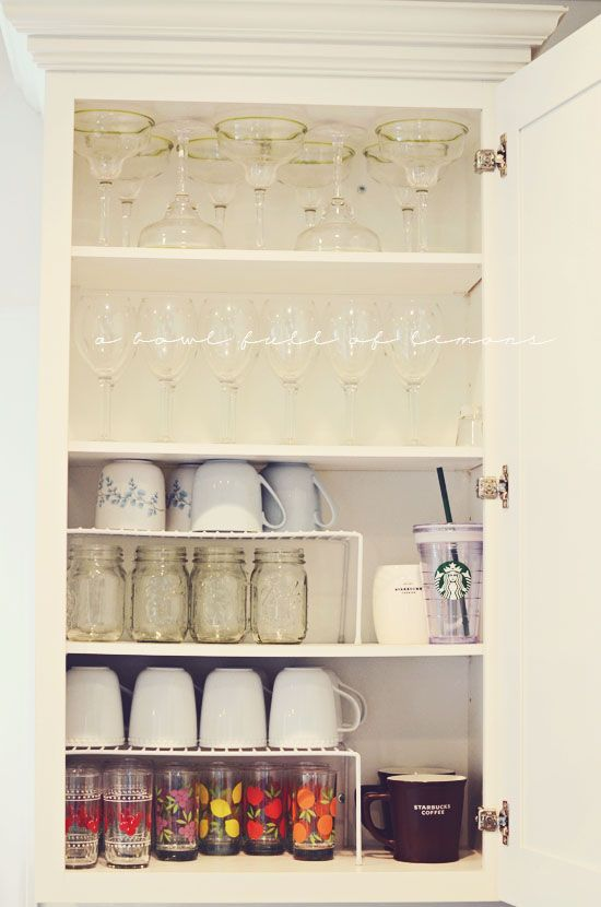 Stacking glasses and mugs doubles up your cabinet space!!! These wire shelves are from Walmart.