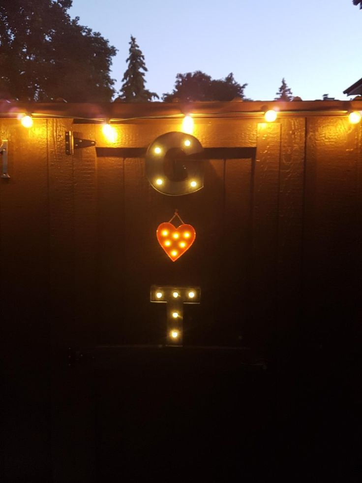 Shed decorated with lights and G ♡ T light boxes