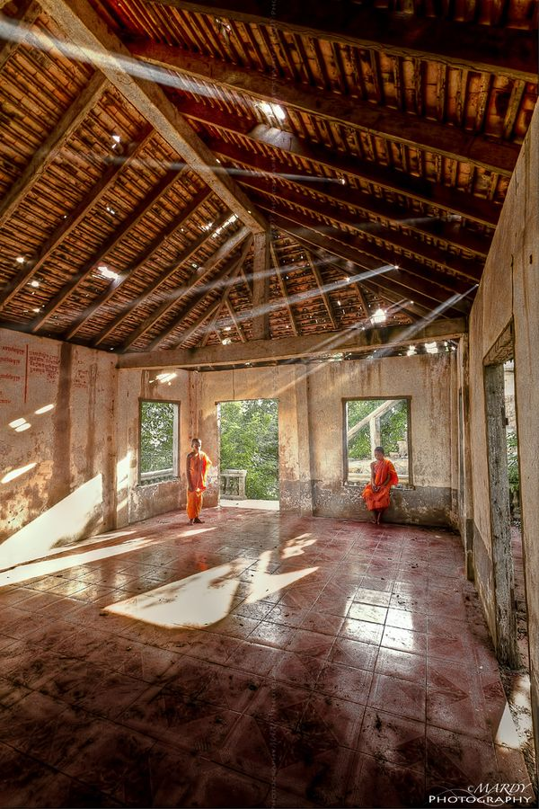 This two young monk, they stay in the pagoda on the mountain at Kampong Spoue province, Cambodia.
