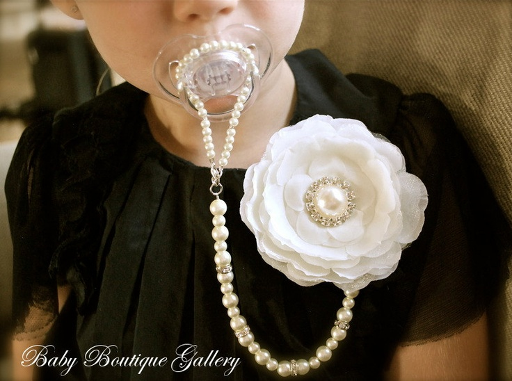 Baby Boutique Ivory Flower 4-in-1 Beaded Pacifier Holder. $27.99, via Etsy.