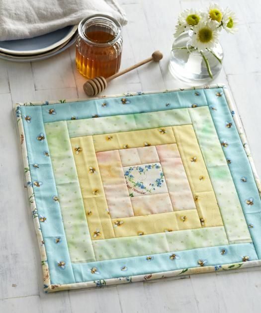 Make a table mat that radiates rainbows with a simple quilt-as-you-go method!