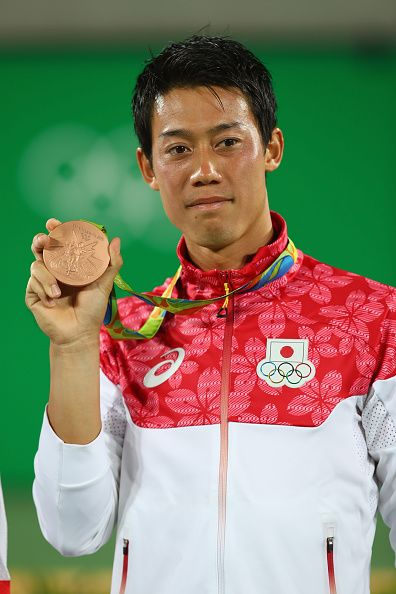 Bronze medalist Kei Nishikori of Japan poses during the medal ceremony for the…