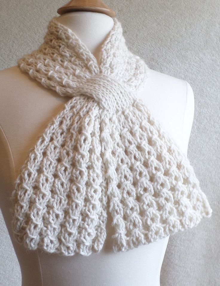 Free Knitting Pattern for 4 Row Repeat Loopy Lace Scarf - This keyhole scarf features a reversible 4-row repeat lace honeycomb stitch and a loop to keep it in place! Designed by Katie Harris. Pictured project by crumbgrubbers