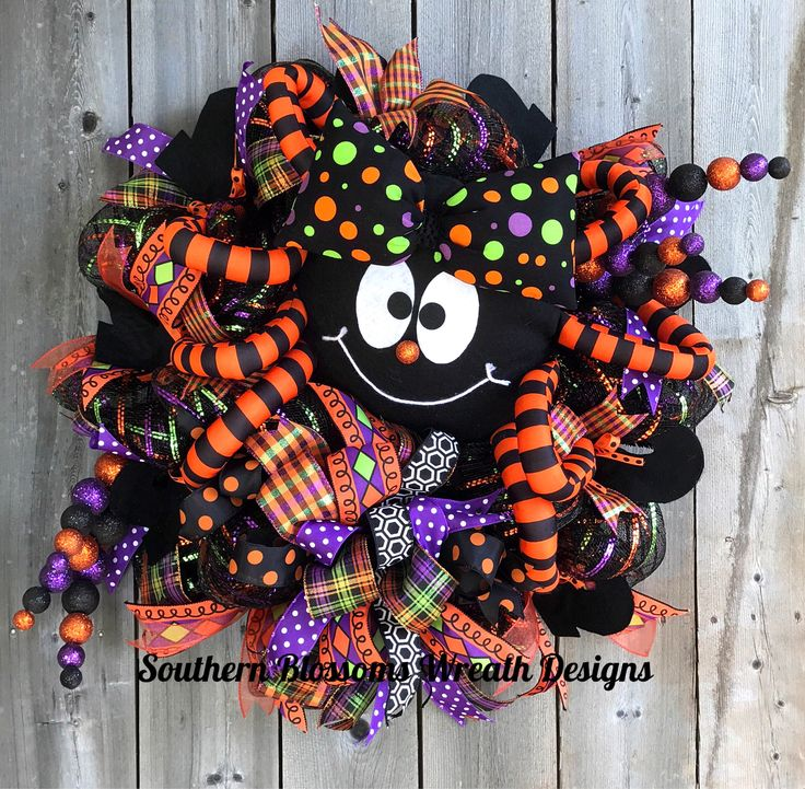 A personal favorite from my Etsy shop https://www.etsy.com/listing/541103995/halloween-wreath-spider-wreath-fall
