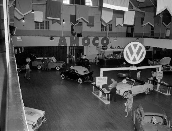 Sign In The Middle Of The Image Reads Brundage Motors The Car Under The Vw Logo Is A Karmann Ghia Volkswagen Car Volkswagen Florida