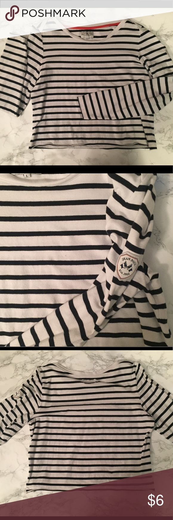 """JENA PAUL HORIZONTAL BLACK AND WHITE STRIPED TEE This shirt is the tiniest bit cropped. Black and white thin horizontal stripes. A little patch on the left arm with """"Jean Paul."""" Size women's large. Unsure of the fabric probably a poly/cotton. Jean Paul Gaultier Tops Tees - Long Sleeve"""