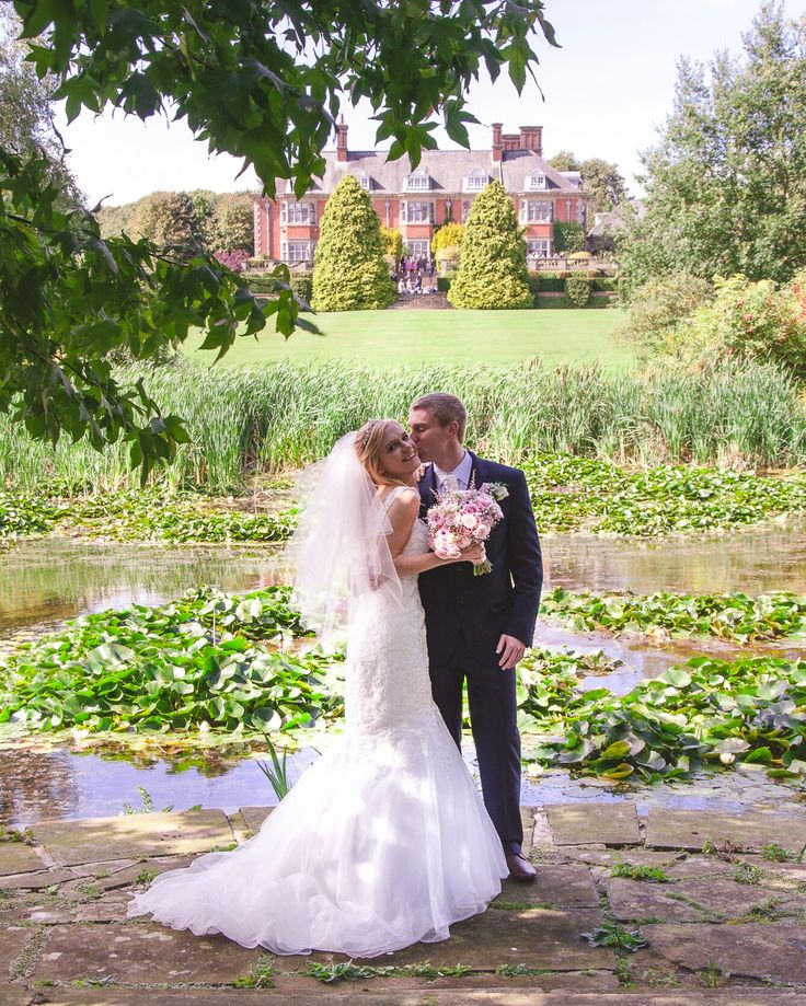 Wedding photography of this beautiful couple at Dunchurch Park Hotel in Warwickshire www.khandiephotography.com her mermaid gown was an amazing choice for a wedding dress.