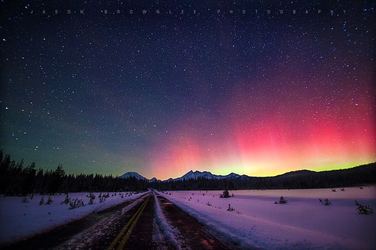 "Astrophotographer Jason Brownlee sent in this stunning photo of an auroral display over central Oregon's Cascade Mountains, taken Oct. 1, 2013. He writes in an e-mail to SPACE.com: ""Winter is starting, and I was lucky enough to shoot the aurora over a snowy landscape for [the] first time."" (https://www.facebook.com/jasonbrownleedesign)"