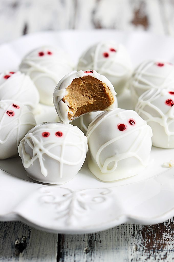 Pumpkin Cheesecake Truffle Mummies by lecremedelacrumb: Easy to make and perfect for halloween parties! #Truffles #Pumpkin #Cheesecake #No_Bake