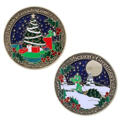 """Season's Greetings Geocoin $13.00 USD Celebrate the Season with Signal the Frog®!  This incredible design that shows Signal on a geocaching adventure where he not only gets a smiley, he also grabs a tree! The color and texture of this coin is truly something that has to be seen to be appreciated. This geocoin will be a great addition to any collection, or is ready to travel and spread holiday cheer from geocache to geocache!  Size: 1.75"""" (4.5 cm) in diameter"""