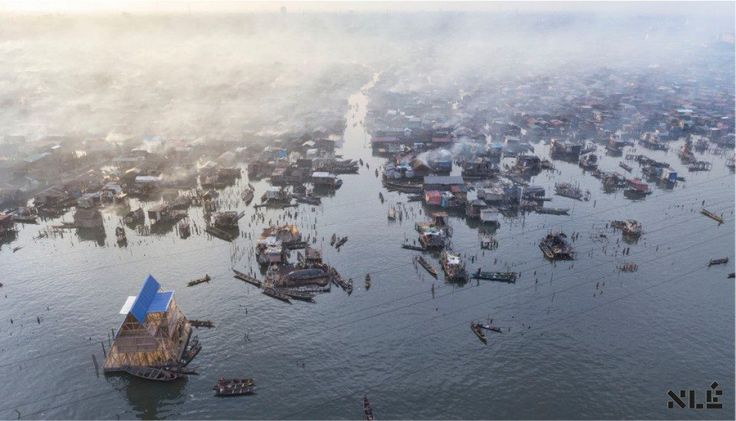 """Makako Floating School by NLÉ - Shaping the Architecture of Developing Cities is an innovative project which reacts to the climate change.  The project was created for a community of Makako, a slum neighborhood of the Lagos Lagoon in Lagos, Nigeria. The project uses local materials which reflect the culture of Makako people. """"Its main aim is to generate sustainable, ecological, alternative building systems and urban water cultures for the teeming population of Africa's coastal regions."""""""