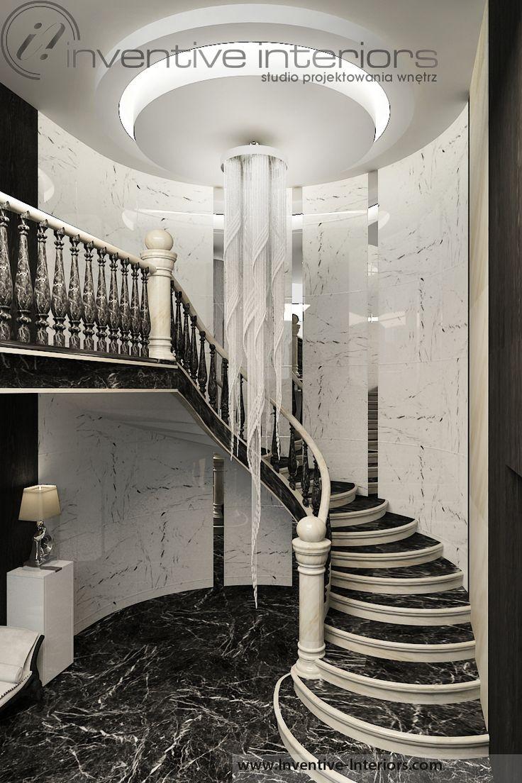 Projekt domu 140m2 Inventive Interiors - jasny hol ze schodami po łuku - długi żyrandol - oryginalny sufit podwieszany - biały i czarny marmur
