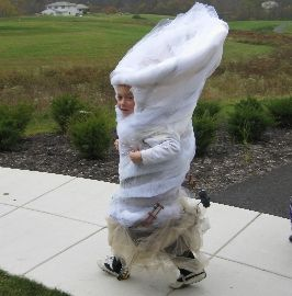 Who wants to chase this little storm? This tornado costume can be built with a tomato cage from the garden.