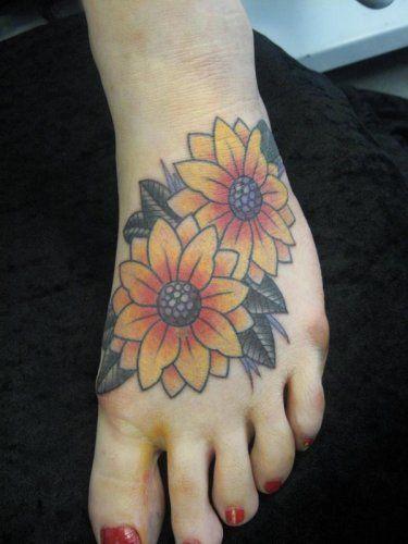 Jen Akenyemi -- Two yellow sunflowers foot tattoo