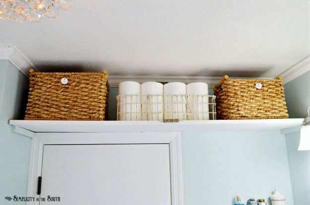Stow extra toiletries and towels up and out of the way. It's an especially helpful tactic in a guest bathroom; you can offer visitors everything they need, but still keep things tidy. See more at Simplicity in the South »