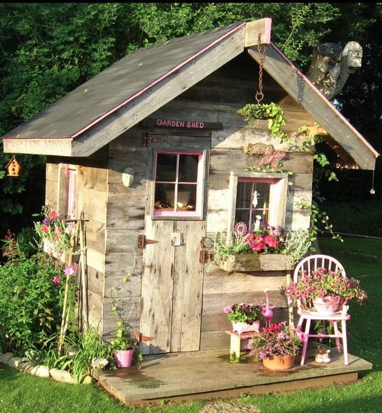 Quaint garden shed in Menominee, Michigan built by Ken Ceesay using recycled materials • photo: Laurie Ceesay on Artsy Chick Quilts