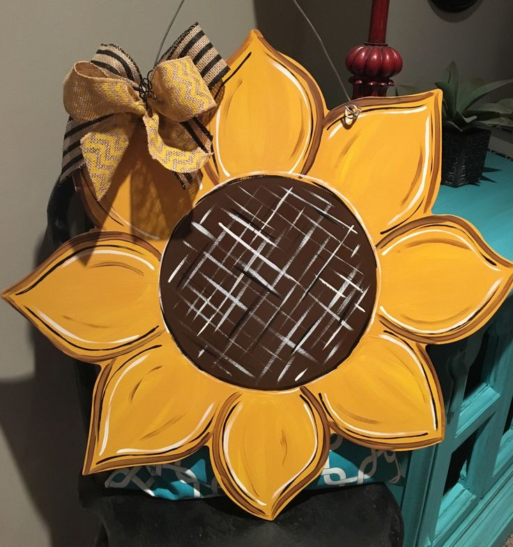 A personal favorite from my Etsy shop https://www.etsy.com/listing/488686390/large-wood-sunflower-door-hanger