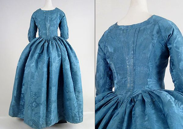 Robe à l'anglaise, England, blue silk damask (mid 18thC), gown altered 1770s.  Interior tapes in the skirt indicate that it was intended to be looped up in a style known as à la polonaise that came into vogue in that decade. Such modifications were common throughout most of the century. Cora Ginsburg