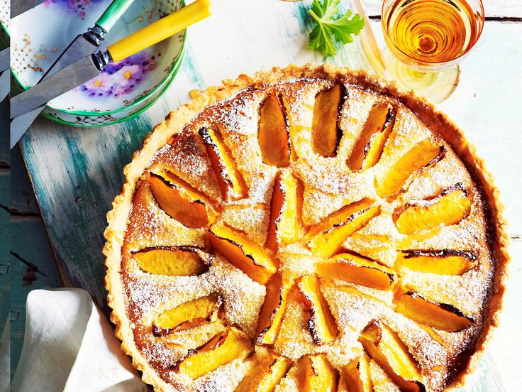Indulge in a baked, fruity treat with this peach and rose frangipane tart. Drizzle with honey to serve and enjoy the peach slices and almond undertones.