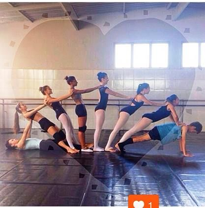 I give these ballet dancers a 10 for creativity! This looks like a great, Japanese fan-like stretch!