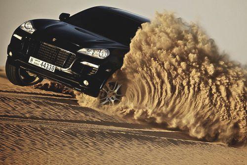 Porsche Cayenne tearing through a desert. A desert!