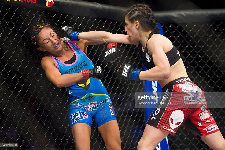 Joanna Jedrzejczyk throws a punch at Carla Esparza during UFC 185 at the American Airlines Center on March 14, 2015 in Dallas, Texas.