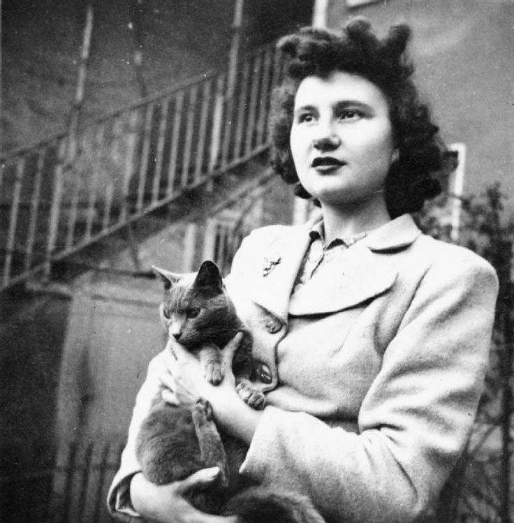 Portrait of Claudette Blance, an intelligence officer in the French Resistance (Maquis) and a lieutenant in the Free French Army, with her cat. Her house was used as a 'safe house' by the 'Jude' Jedburgh Team in 1944.