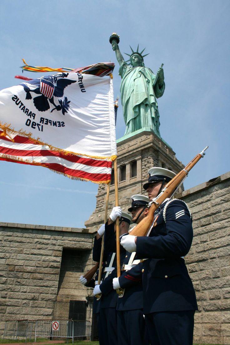 Statute of Liberty and U.S.C.G. members
