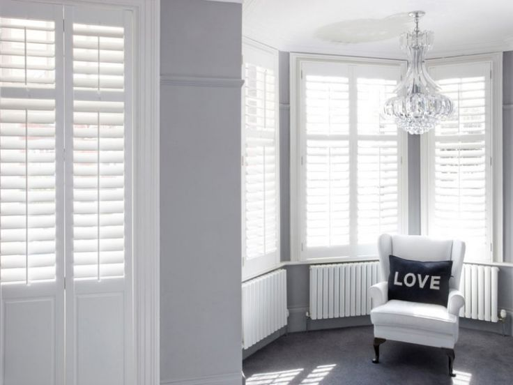 Inspire Me Gallery - The California Shutters and Blinds Co. Grey lounge with chandelier and white shutters