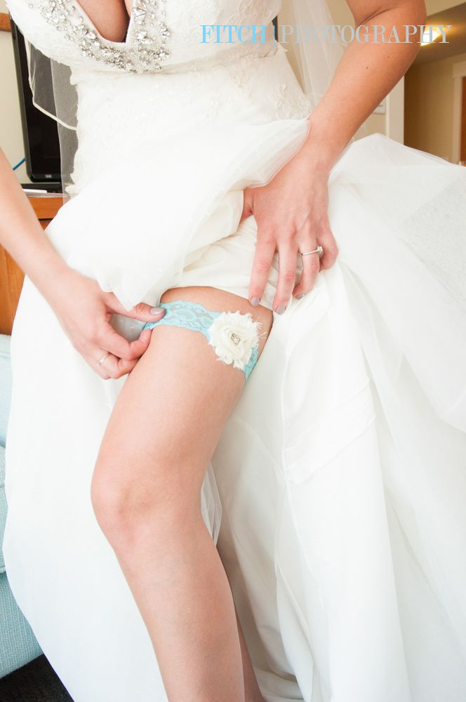Something blue! A lace garter for the beautiful bride in the Okanagan Valley. Katie + Kyle: http://www.fitchphotography.com/#!You-Wont-Want-to-Miss-This-Okanagan-Wedding-in-West-Kelowna/cgla/577bdbf90cf2226bda97d9ae