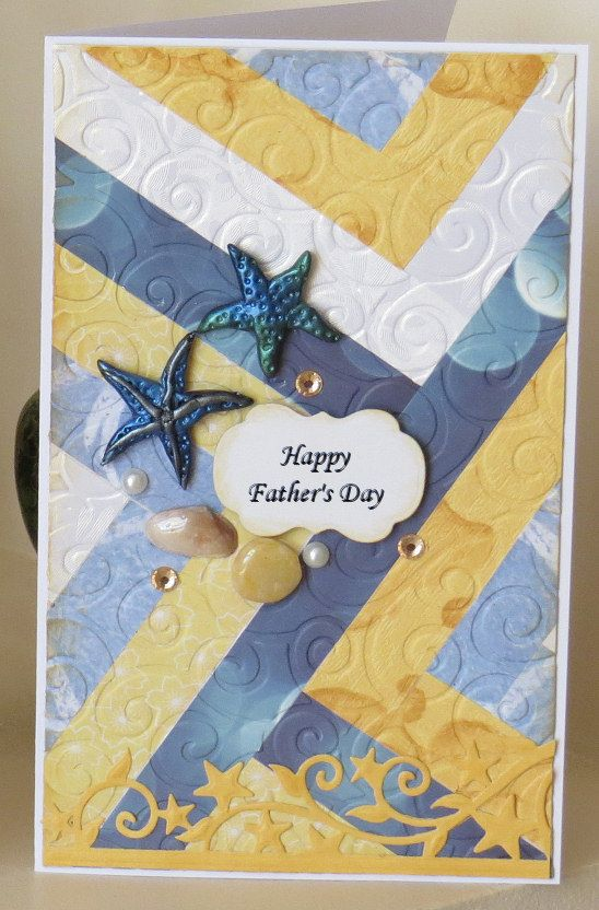 Father's Day card with paper strip quilting design in beach colours. Handmade polymer clay starfish and shells.