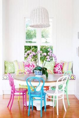 Colourful Bentwood Chairs look amazing with patterned scatter cushions in this casual dining space.