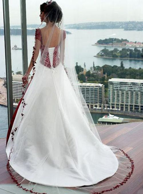 red white wedding dress. iLIKE! This is the DRESS, red & white of gold & white. With a red or gold stripe train. <3 <3 <3