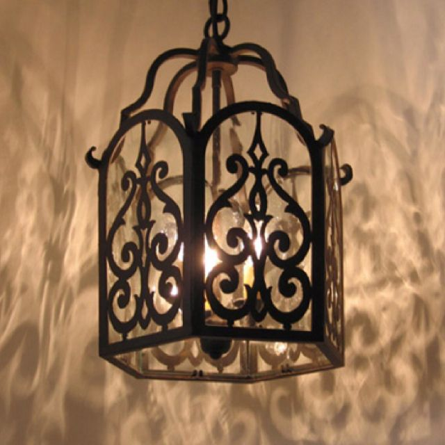 I love the light that this casts! http://www.stevenhandelmanstudios.com/products/wrought-iron-chandeliers.php
