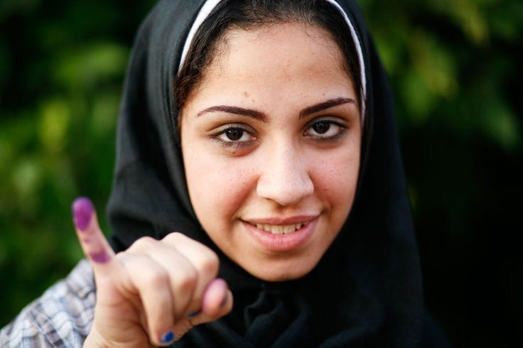 """""""I've never felt this happy before. All I can think of is the martyrs; I feel their dreams are starting to become realised. I voted for Hamdeen Sabahi."""" - Mona Mohamed, 22"""